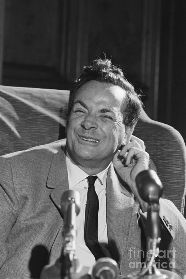 Richard Feynman Seated Smiling Photograph by Bettmann