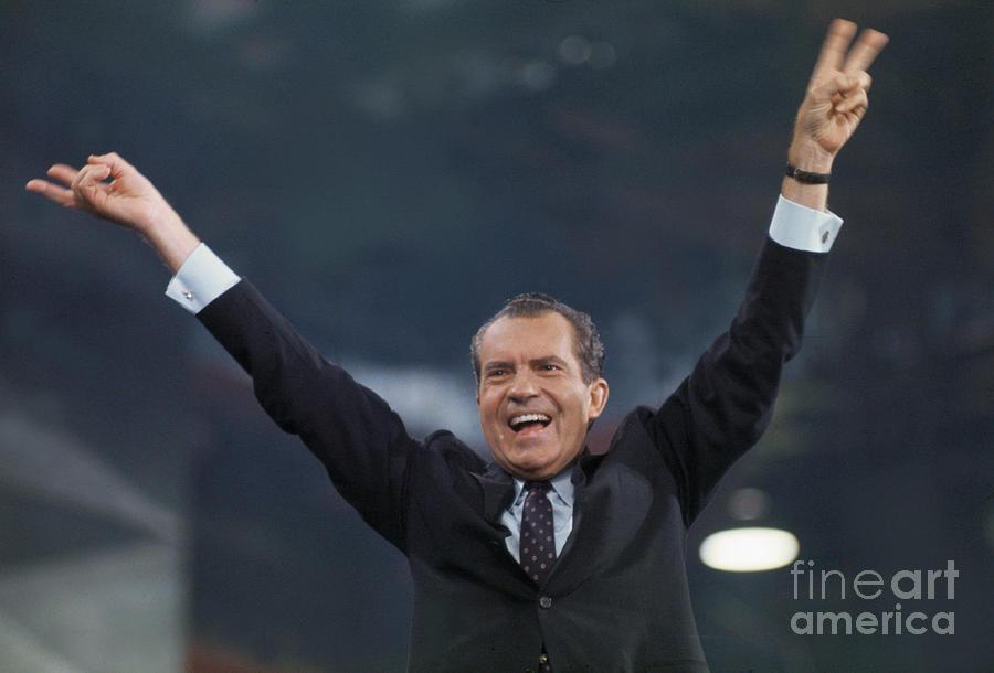 Richard Nixon Raising His Arms To Crowd Photograph by Bettmann