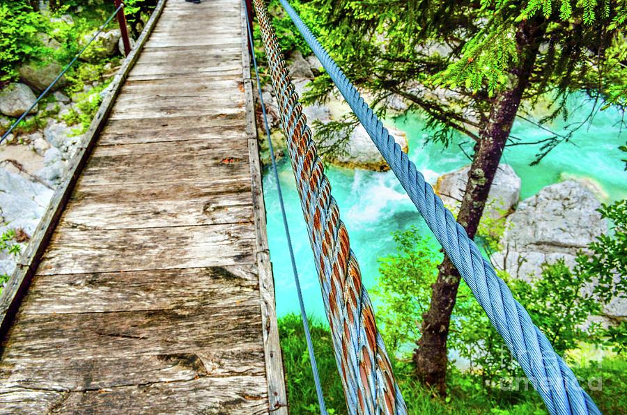 rickety bridge handrail footbridge river background wooden boards by Luca Lorenzelli