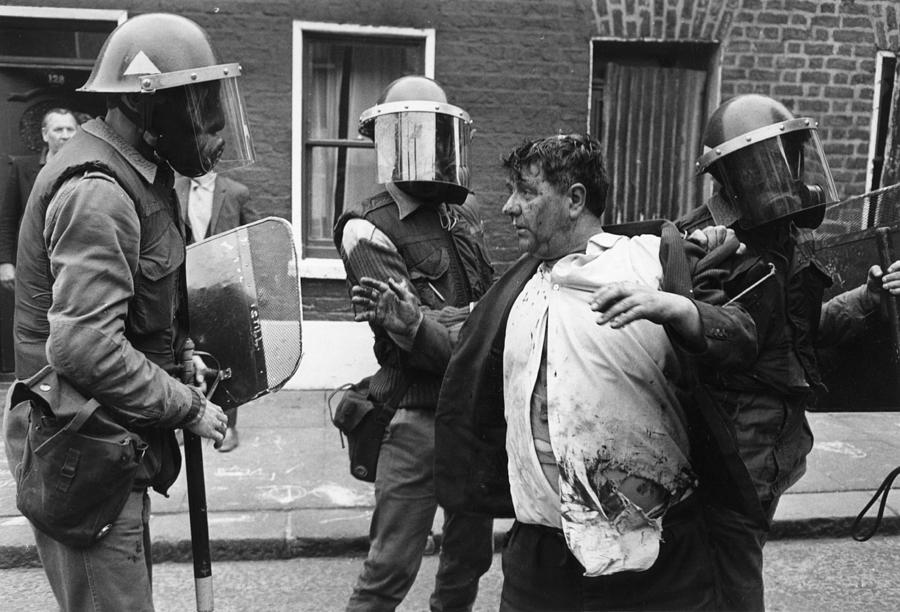 Riot Squad Photograph by Malcolm Stroud