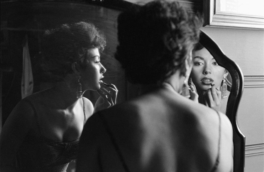 Rita Moreno Putting On Lipstick In Photograph by Loomis Dean