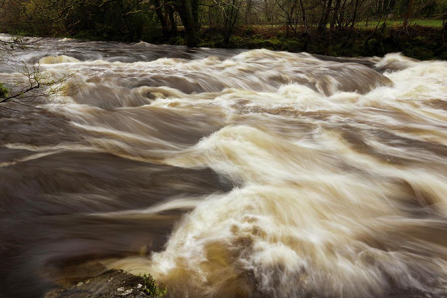River Dart, Devon, In Flood After Heavy Photograph by Moorefam