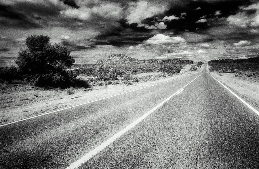 Road Running Through Desert, Hills And Photograph by Dennis Oclair