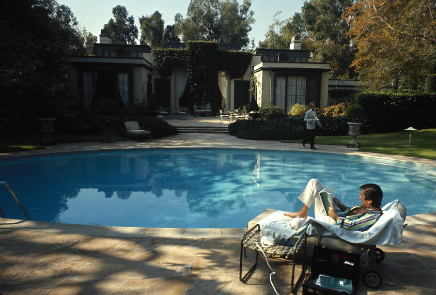 Robert Evans Reads Poolside Photograph by Alfred Eisenstaedt