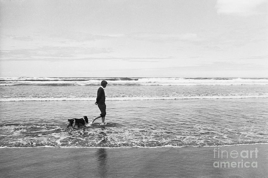 Robert Kennedy Walking On Beach With Dog Photograph by Bettmann