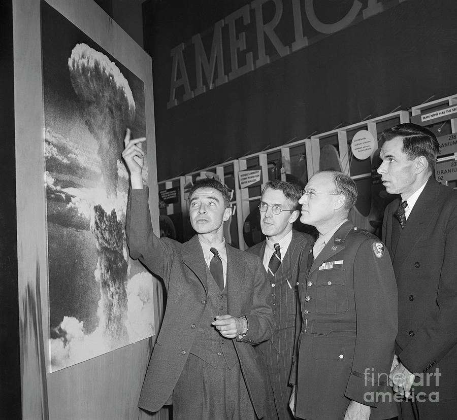 Robert Oppenheimer Pointing To Picture Photograph by Bettmann