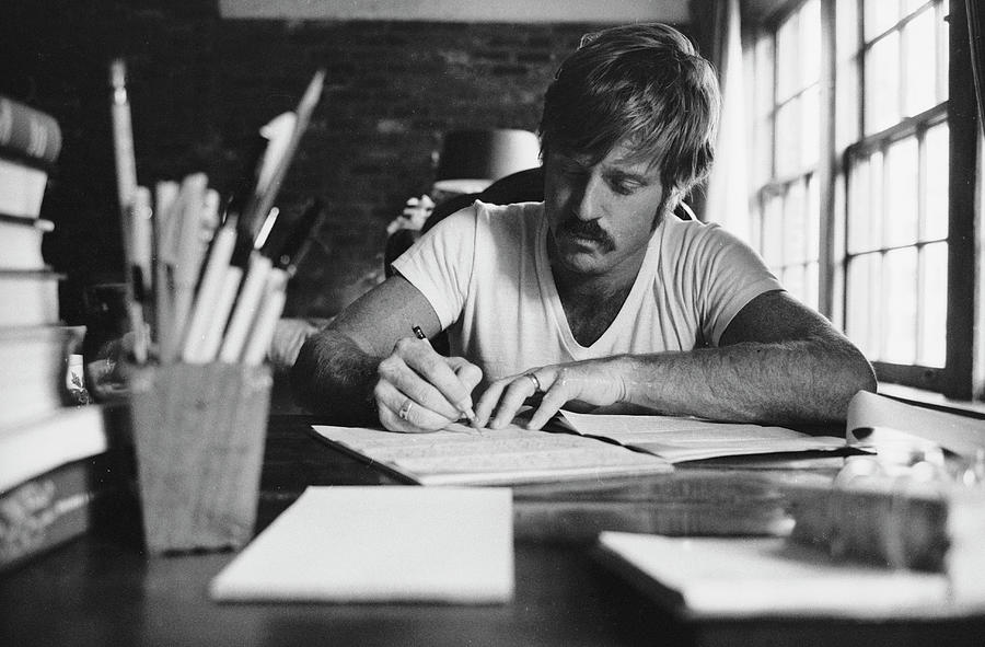 Robert Redford Writing At Desk Photograph by John Dominis