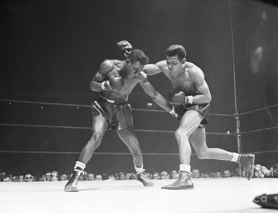Robinson Throws Punch In Title Match Photograph by Bettmann