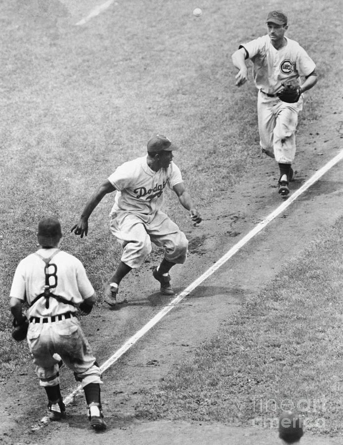 Robinson Trapped Between Third And Home Photograph by Bettmann