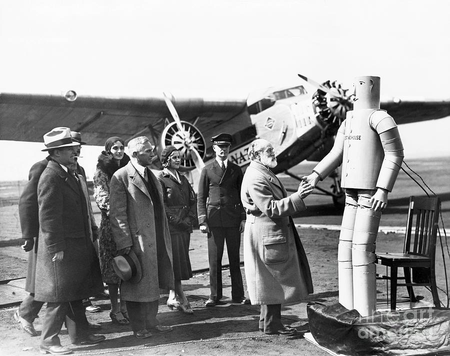 Robot Shakes Elderly Pilots Hand Photograph by Bettmann
