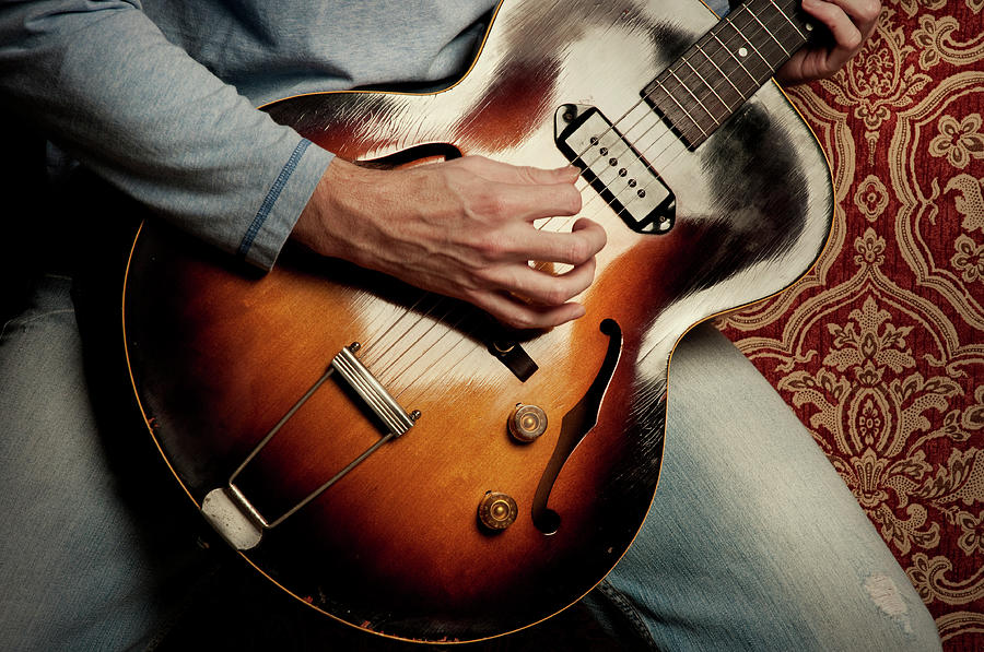 Rock N Roll Guitar On Black Background Photograph by Bns124