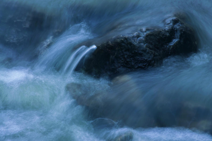 Rock Poking Through Swirling Warter Photograph by Anthony Paladino