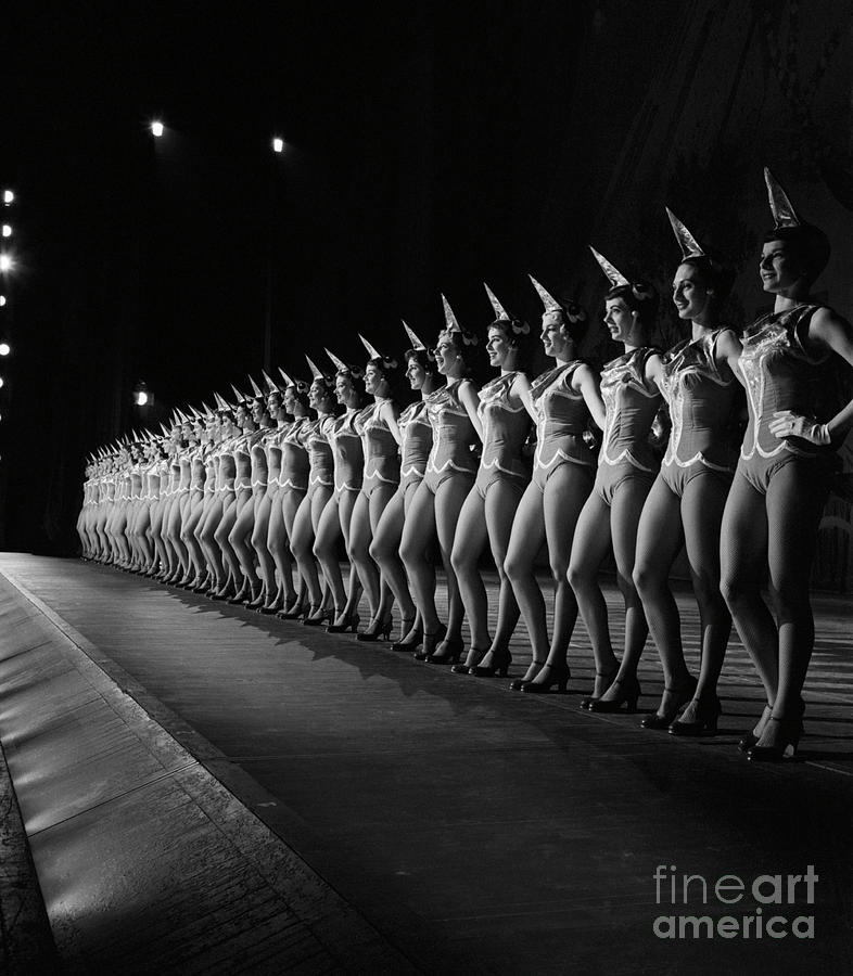 Rockettes Lined Up In Costume Photograph by Bettmann