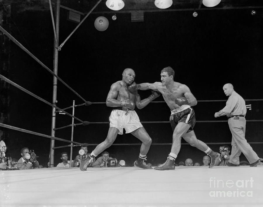 Rocky Marciano Boxing Joe Walcott Photograph by Bettmann