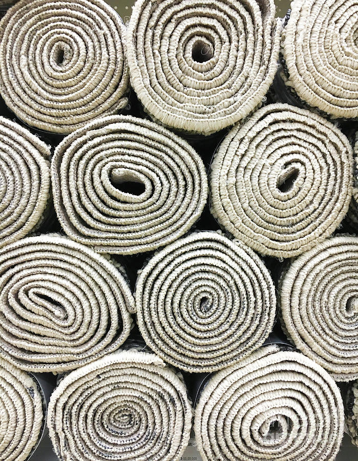Rolled rugs background by Tom Gowanlock