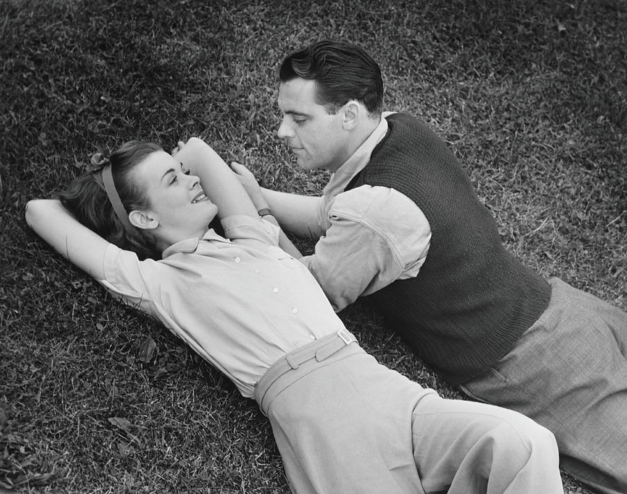 Romantic Couple Lying On Grass, B&w Photograph by George Marks
