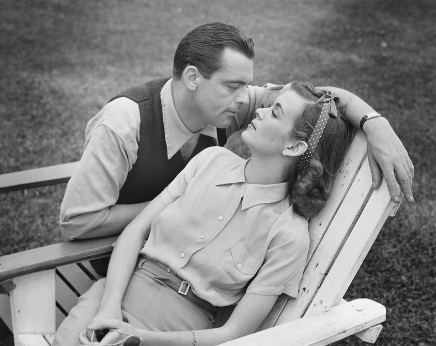 Romantic Couple Relaxing On Deckchair Photograph by George Marks