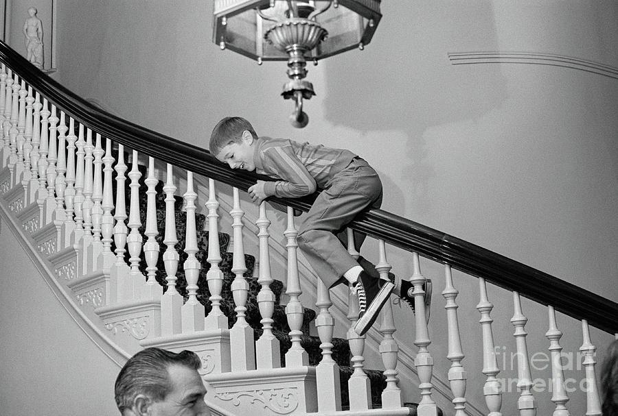 Ronald Reagan, Jr. Sliding Down Stair Photograph by Bettmann