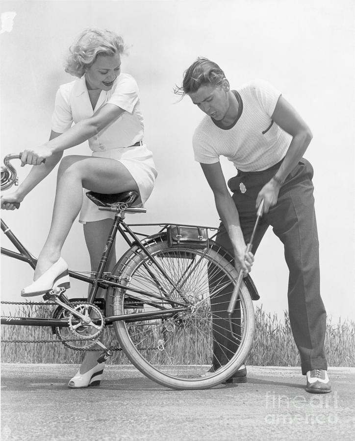 Ronald Reagan Pumping Bicycle Tire Photograph by Bettmann