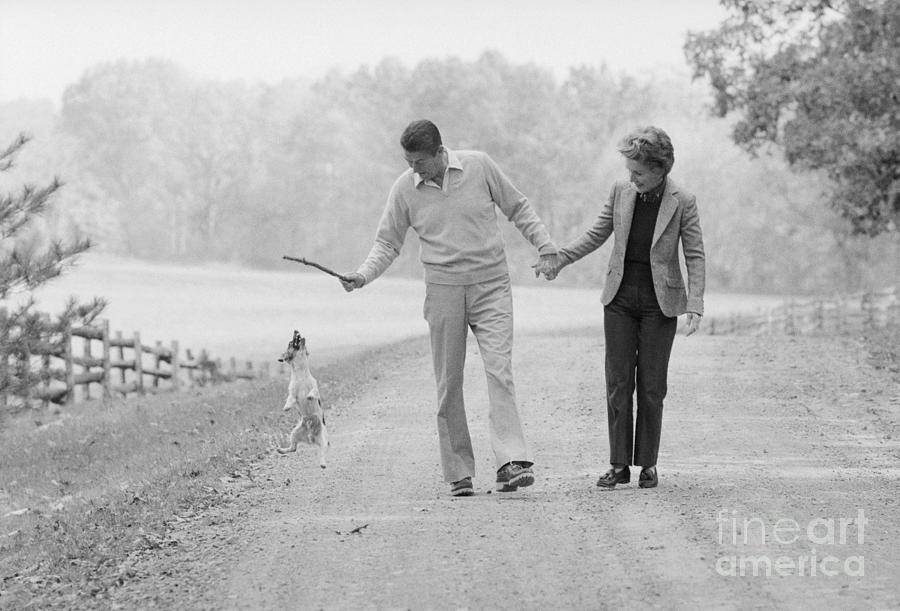 Ronald Reagan Strolling With His Wife Photograph by Bettmann