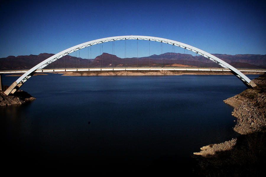 Roosevelt Lake Bridge Arizona by Roger Passman