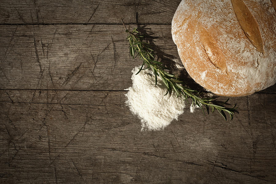 Round Bread On A Wooden Table Photograph by Infrontphoto