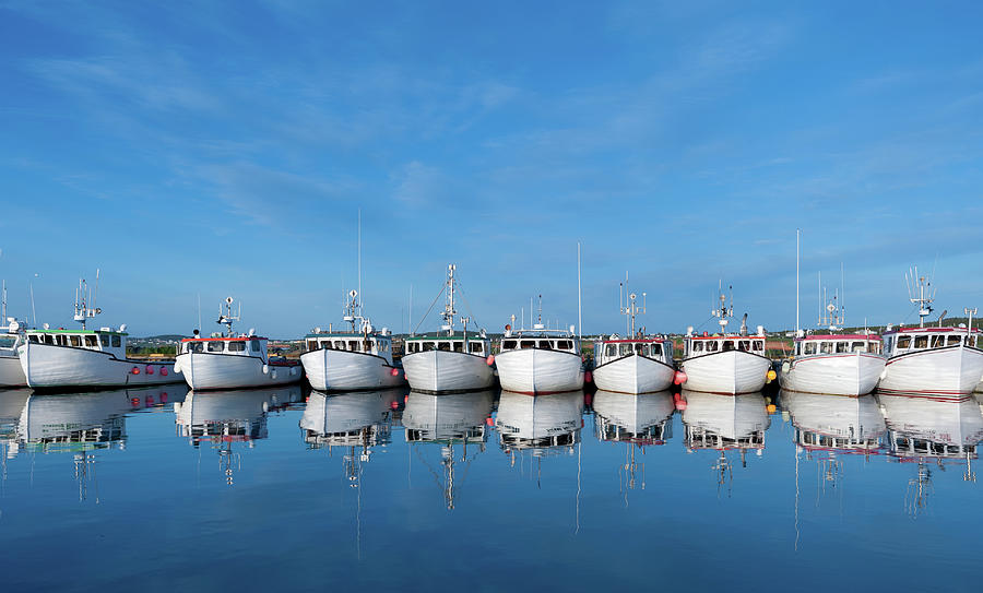 Row Of Boats With Reflection Photograph by Pndtphoto