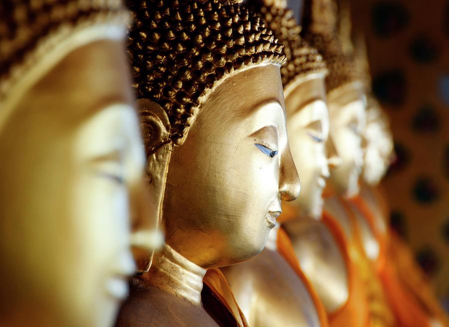 Row Of Buddhas At Wat Arun, Bangkok Photograph by Leontura