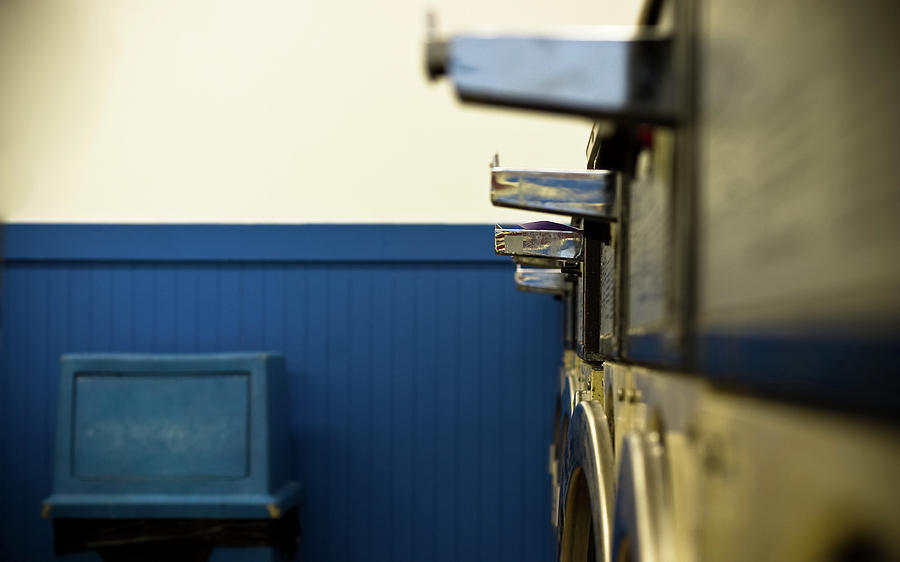 Row Of Washing Machines In Laundromat Photograph by Meera Lee Sethi