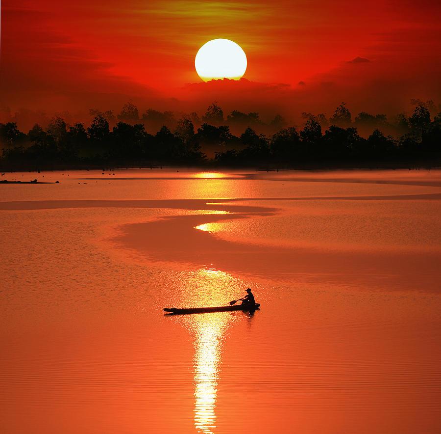 Sun Photograph - Rowling Alone by Sarawut Intarob