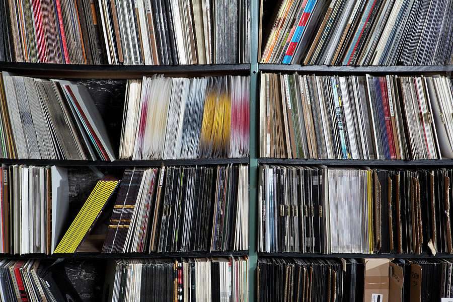 Rows Of Records On Shelves Photograph by Halfdark