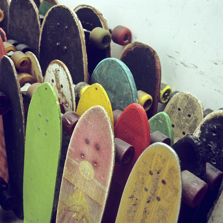 Rows Of Used Skateboards Leaning Photograph by Fstop Images - Brian Caissie