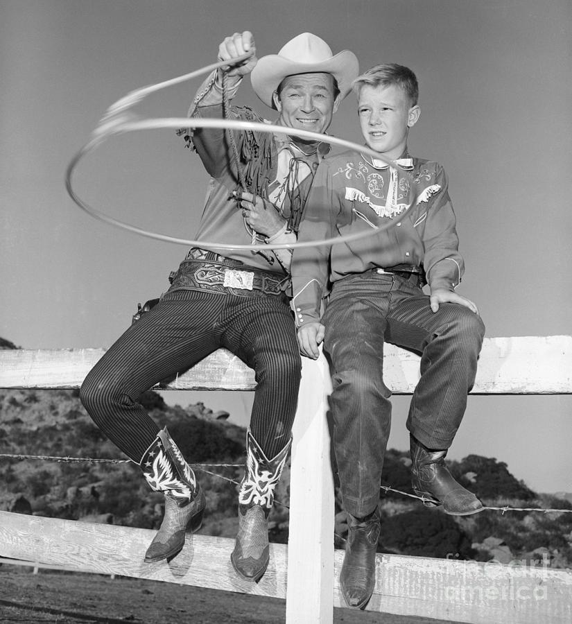 Roy Rogers Shows Son His New Invention Photograph by Bettmann
