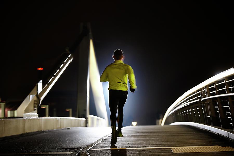 Runner On Bridge Photograph by Henrik Sorensen