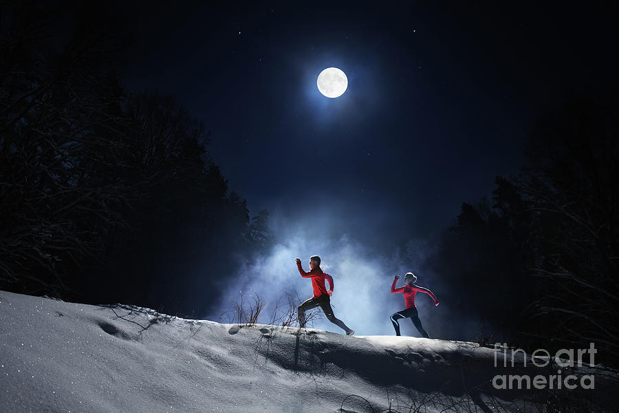 Runners At Night On Snowy Forest Photograph by Stanislaw Pytel
