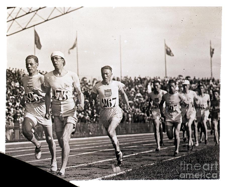 Runners Finish Olympic Race Photograph by Bettmann