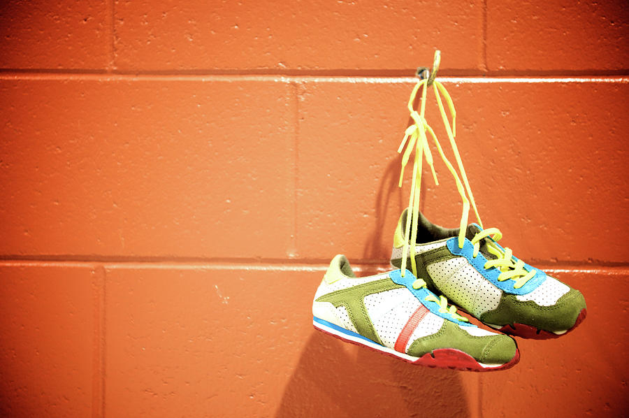 Runnig Shoes Hanging On A Hook Photograph by Pascalgenest