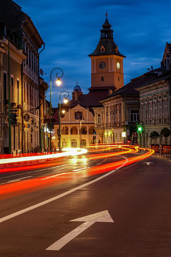 Street Photograph - Rush Hour In The City Of Brasov In Transylvania, Romania. by George Afostovremea