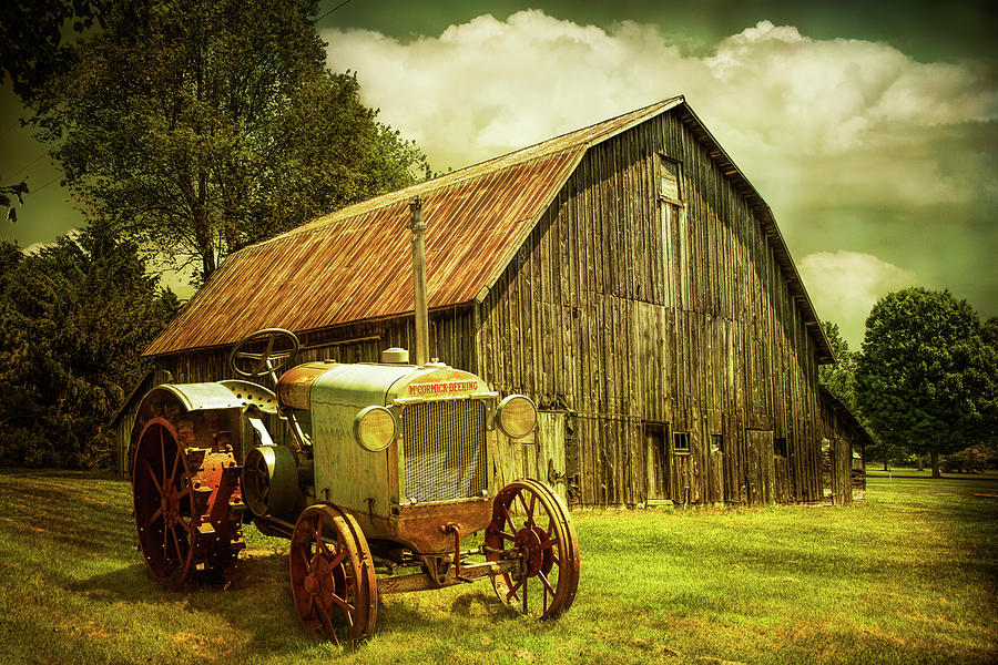 Rustic Scene of an Old Vintage McCormick Deering Tractor with ol by Randall Nyhof