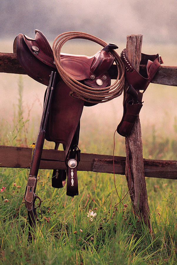 Saddle And Lasso On Fence Photograph by Comstock