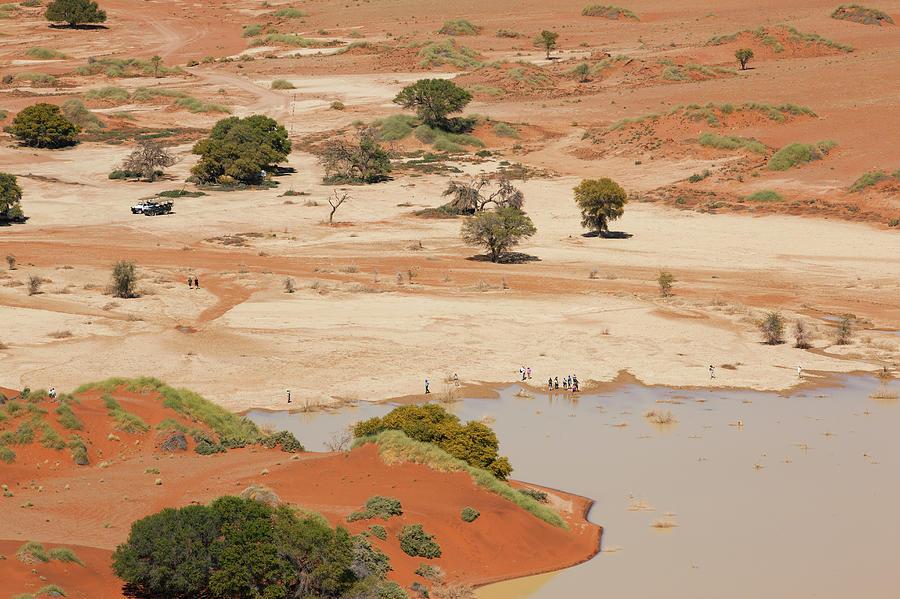 Safari Tourists By Sossusvlei Pan Photograph by Bjarte Rettedal