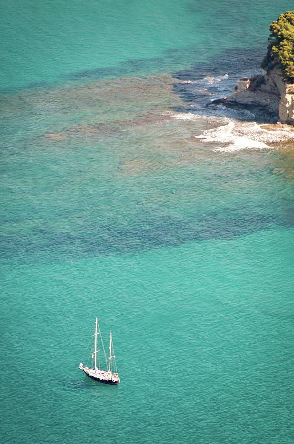 Sailboat In Clear Mediteranean Waters Photograph by Photo By P.folrev