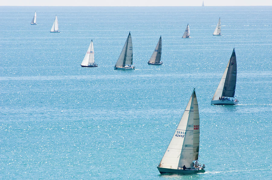 Sailboats Racing On Blue Water Photograph by By Ken Ilio