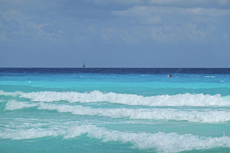 Sailing and Jet Skiing on the beautiful blue water of Cancun Beach Cancun Mexico by Toby McGuire