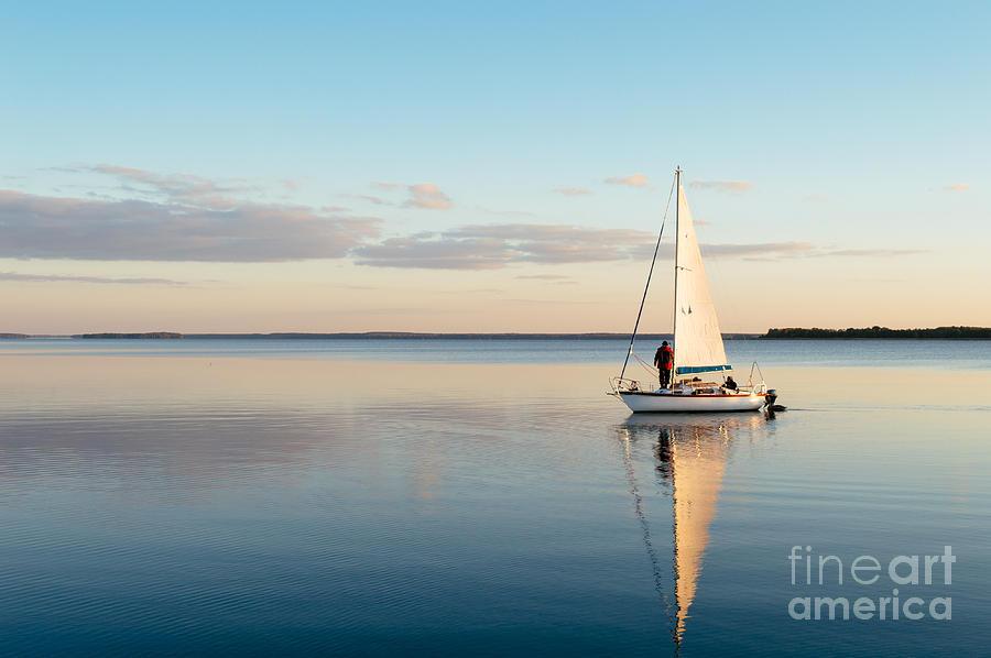 Sailboat Photograph - Sailing Boat On A Calm Lake by Wstockstudio