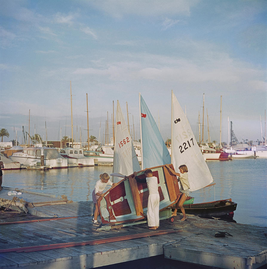 Child Photograph - Sailing Dinghy by Slim Aarons