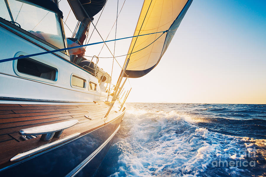 Sailboat Photograph - Sailing To The Sunrise by Epicstockmedia