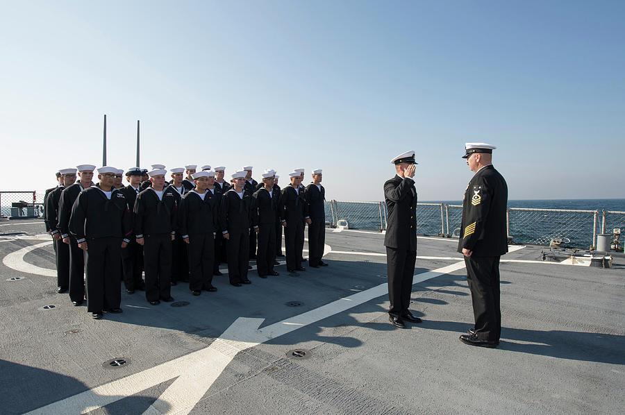 Sailors Conduct A Dress Blue Uniform by Stocktrek Images