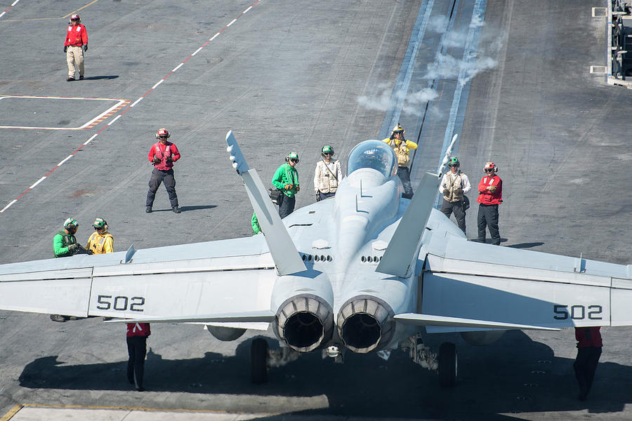 Military Photograph - Sailors Direct An Ea-18g Growler by Stocktrek Images
