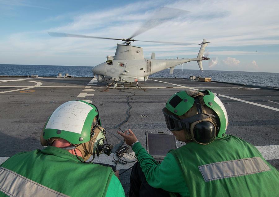 Navy Photograph - Sailors Prepare To Launch An Mq-8b Fire by Stocktrek Images